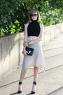 Black-clutch-sophie-hulme-bag-black-cat-eye-ray-ban-sunglasses