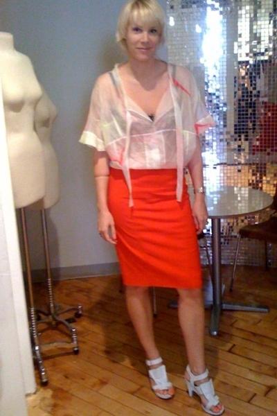 Valentino skirt - Chloe shirt - Elle MacPherson bra - Givenchy shoes