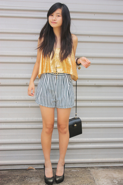 gold cotton on top - gold zu shoes - black thirfted shorts