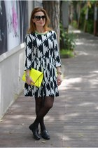 Black and white dress, yellow clutch
