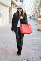 ruby red Prada bag