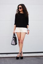 nude romwe shorts - black H&M sweater - black Nelly wedges