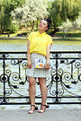 Yellow-vessos-shirt-black-sandals