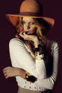 Carrot-orange-floppy-hat-cream-cut-outs-sweater-black-chunky-bracelet-ligh