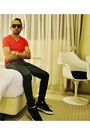Red-v-neck-stretchy-shirt-black-sunglasses-green-sneakers