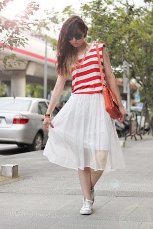 white skirt - carrot orange bag - red top