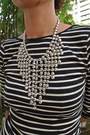 Silver-tiered-necklace-mphosis-necklace-black-zara-top