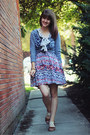 Black-polka-dot-dress-ivory-bird-patterned-shirt-maroon-floral-skirt