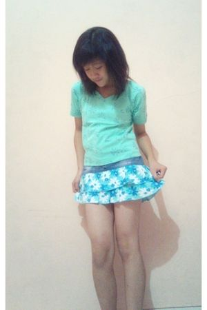 green top - blue shorts