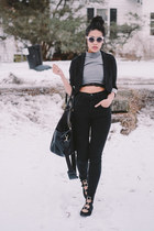black high-waisted BDG jeans - black duffel H&M bag