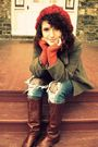 Orange-sweater-brown-coat-blue-jeans-purple-tights-brown-boots-red-hat