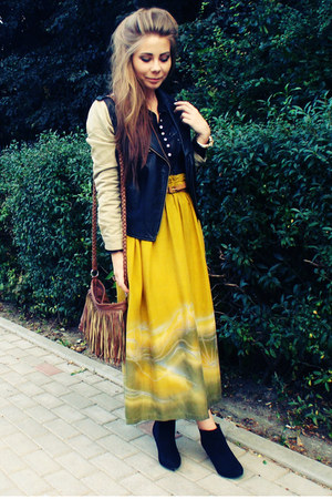 black jacket - black boots - mustard skirt