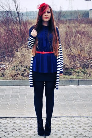 red hat - navy blouse