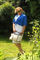 white eyelet dress dress - blue cotton shirt - beige straw bag - green glasses