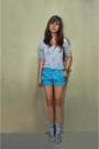 Turquoise-blue-folded-and-hung-shorts-light-blue-blouse