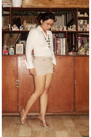 tan shorts - white blouse - necklace - heels