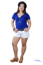Green-purse-black-hat-white-shorts-tawny-wedges-blue-top
