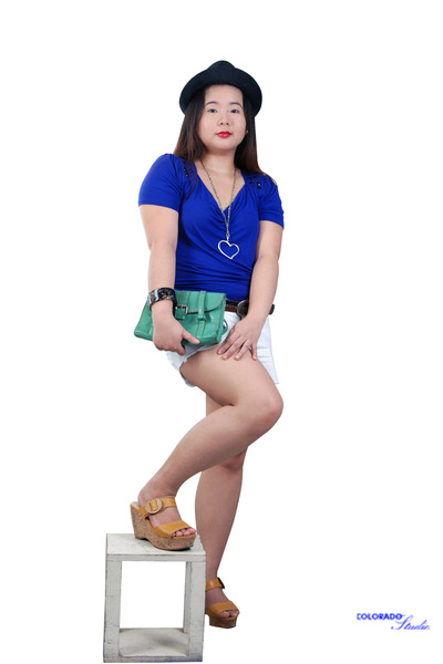 green purse - black hat - white shorts - tawny wedges - blue top