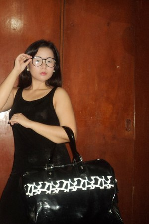 black geek glasses - black shift dress - black zebra print bag