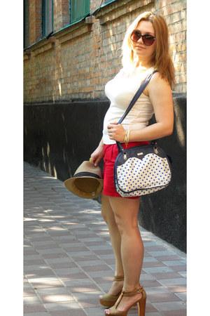 white bag - mustard hat - carrot orange shorts - mustard heels - white top