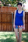 Red-shorts-blue-blouse