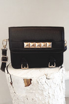 Black-studded-satchel-number-a-purse