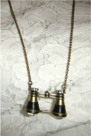 black binoculars Fossil necklace