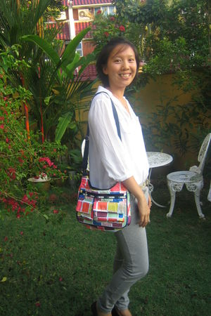 red le sportsac bag - gray Zara pants - white Saramary top