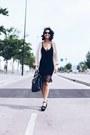 Black-woman-secret-dress-camel-mi-co-sweater-black-marks-spencer-bag