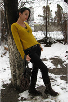 gold knit blouse - dark brown leather boots boots - black jeans - green earrings