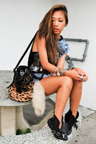beige Alexander Wang bag - black boots - blue cut off denim Levis 501 shorts