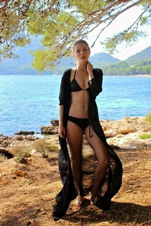 black Missguided cape - black Triangl swimwear - gold xantha necklace