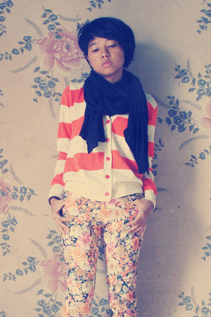black scarf - carrot orange sweater - light orange pants