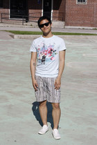off white shoes - tan shorts - black sunglasses - light blue t-shirt