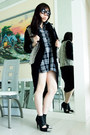 Black-knitted-spiral-girl-jacket-navy-checkered-unknown-skirt