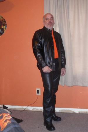 leather pants - black boots - jacket - orange t-shirt
