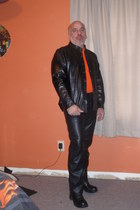 leather pants - black boots - jacket - orange t-shirt