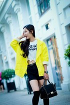 black bag - yellow coat - black shorts - white bodysuit