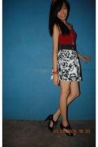 red top - white skirt - black shoes