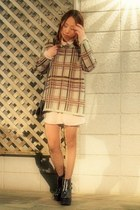 black busted Jeffrey Campbell boots - tan used sweater