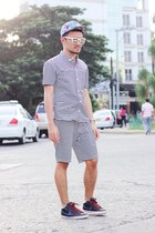 white Yves Camingue shirt - blue nike shoes - violet UNDRGRD hat