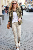ivory boots - eggshell jeans - army green jacket - brown bag - white t-shirt
