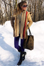 Black-boots-camel-coat-deep-purple-jeans-off-white-sweater